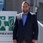 Photo of Greg Kesterman standing in front of Hamilton County Public Health logo